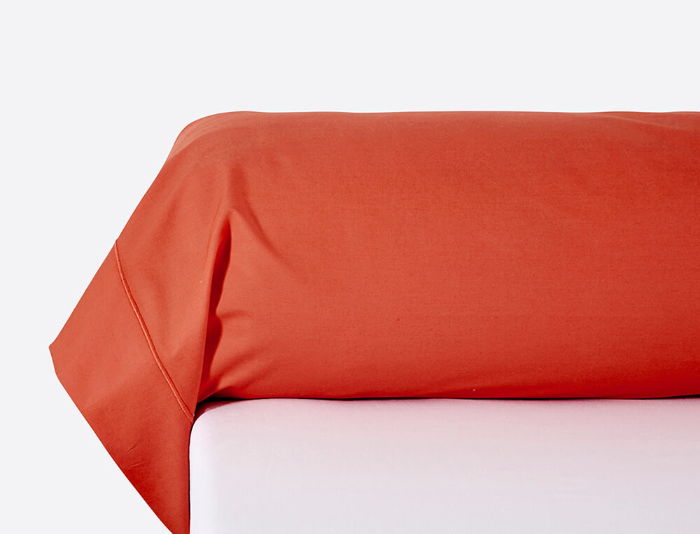 Taie de traversin percale unie orange À Manhattan